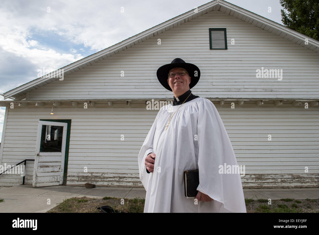 St. Paul's Episcopal Church rector Keith Axberg leads a promenade of approximately 100 dancers down Main Street - Stock Image