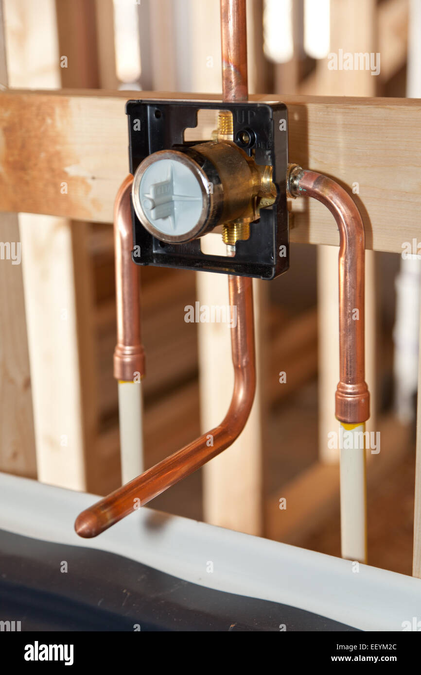 Plumbing for a new home, the copper pipes for bathtub faucet Stock ...