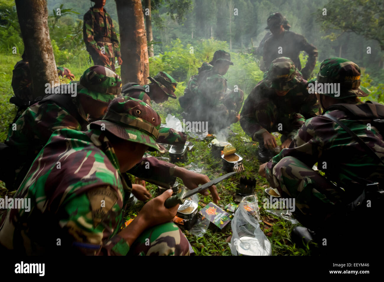 Indonesian marines taking breakfast before search and rescue mission Sukhoi Superjet 100 crash in Mount Salak region, - Stock Image