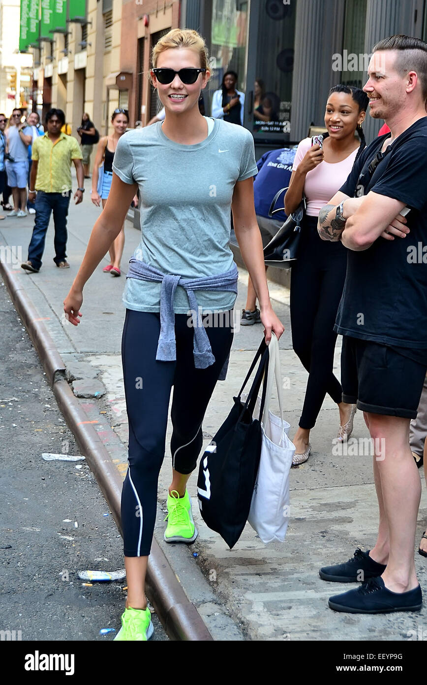 d8627c0cfced Taylor Swift showing a lot of skin in shorts and a white tank top while out  and about in Manhattan with Karlie Kloss. Swift was spotted carrying her go-to  ...