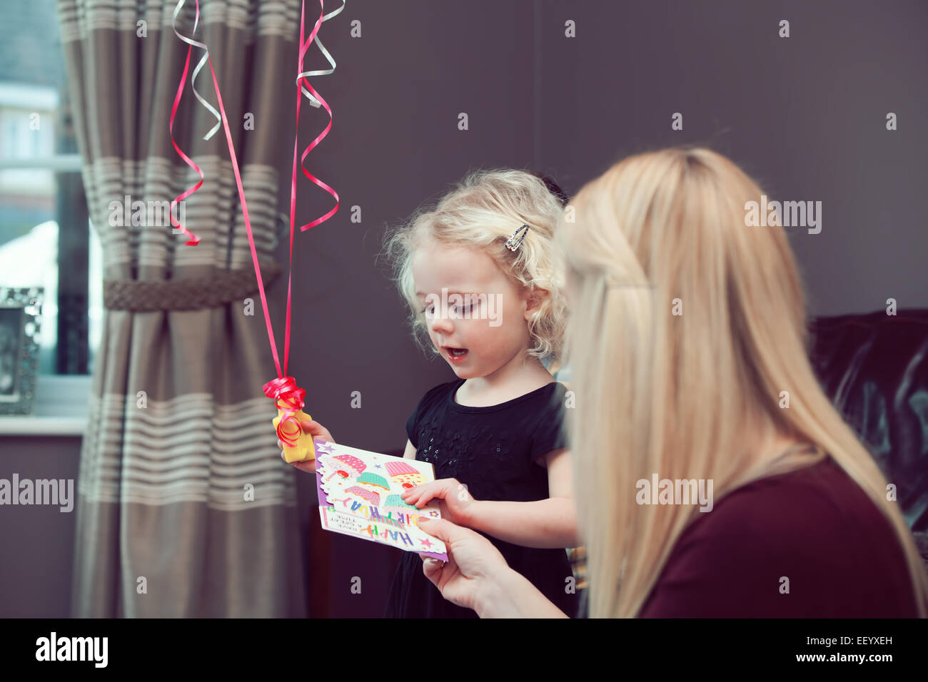 Mother Giving Daughter Birthday Card