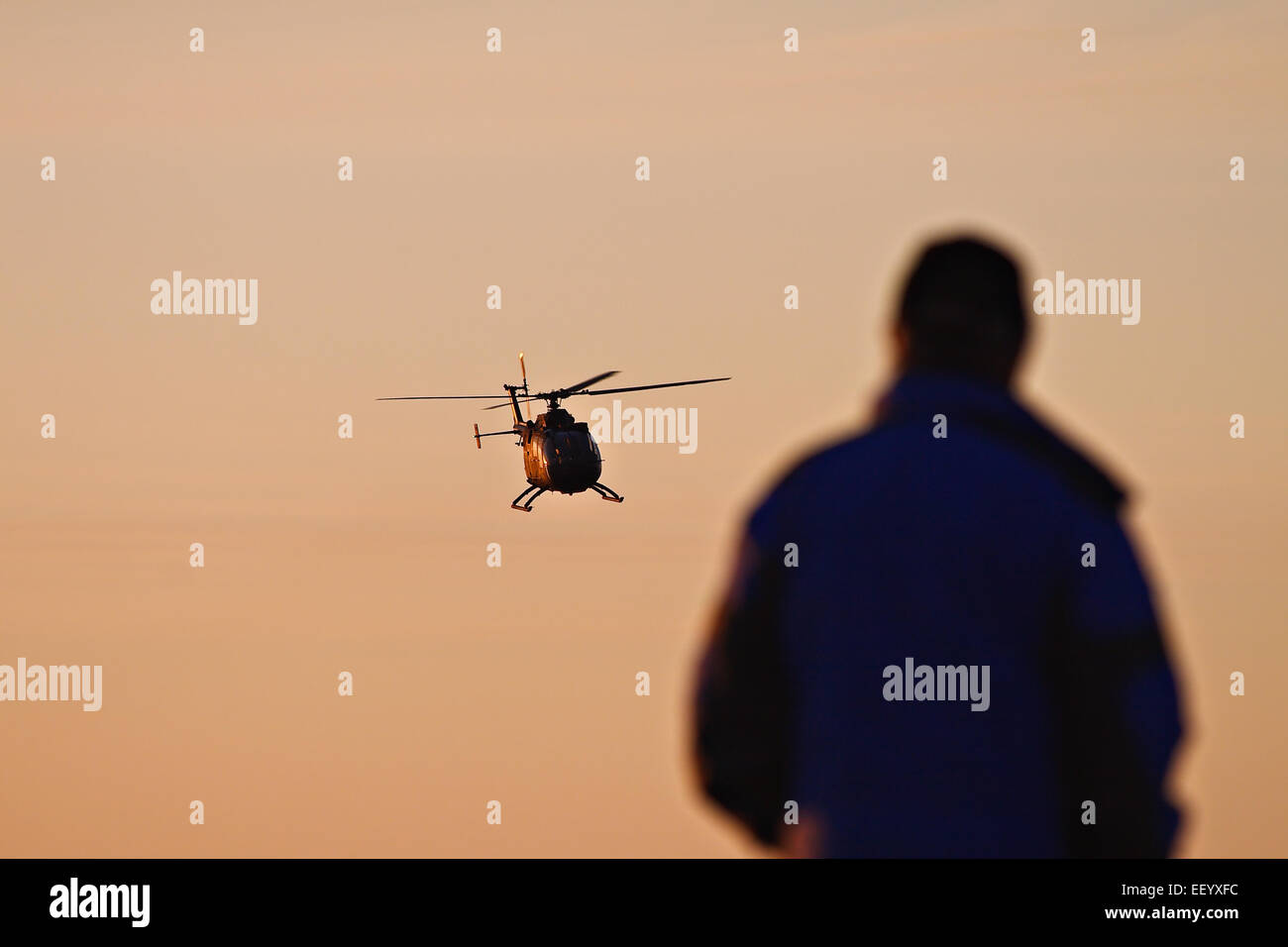 Helicopter and observers. - Stock Image