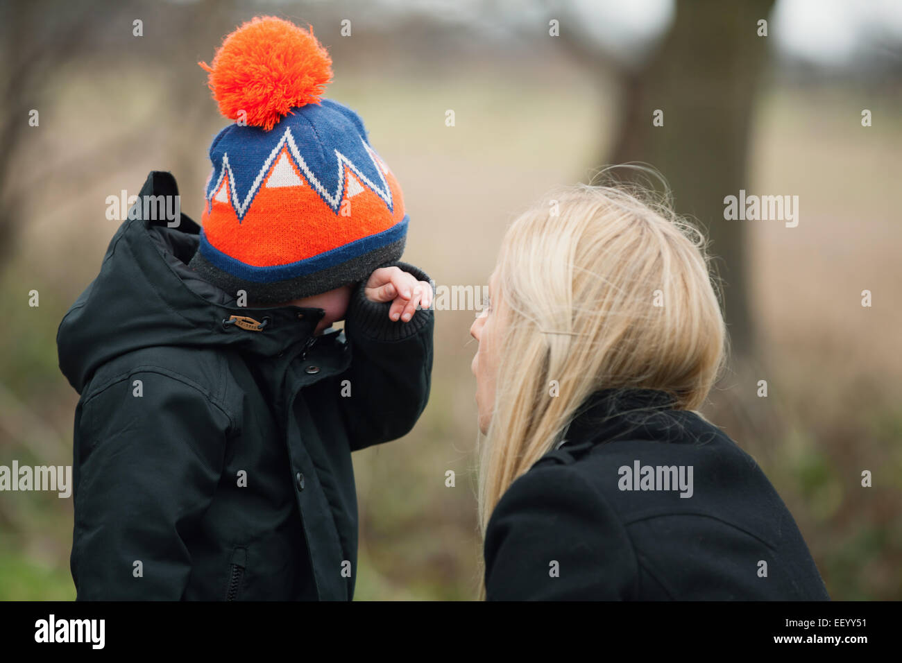 mother consoling son - Stock Image