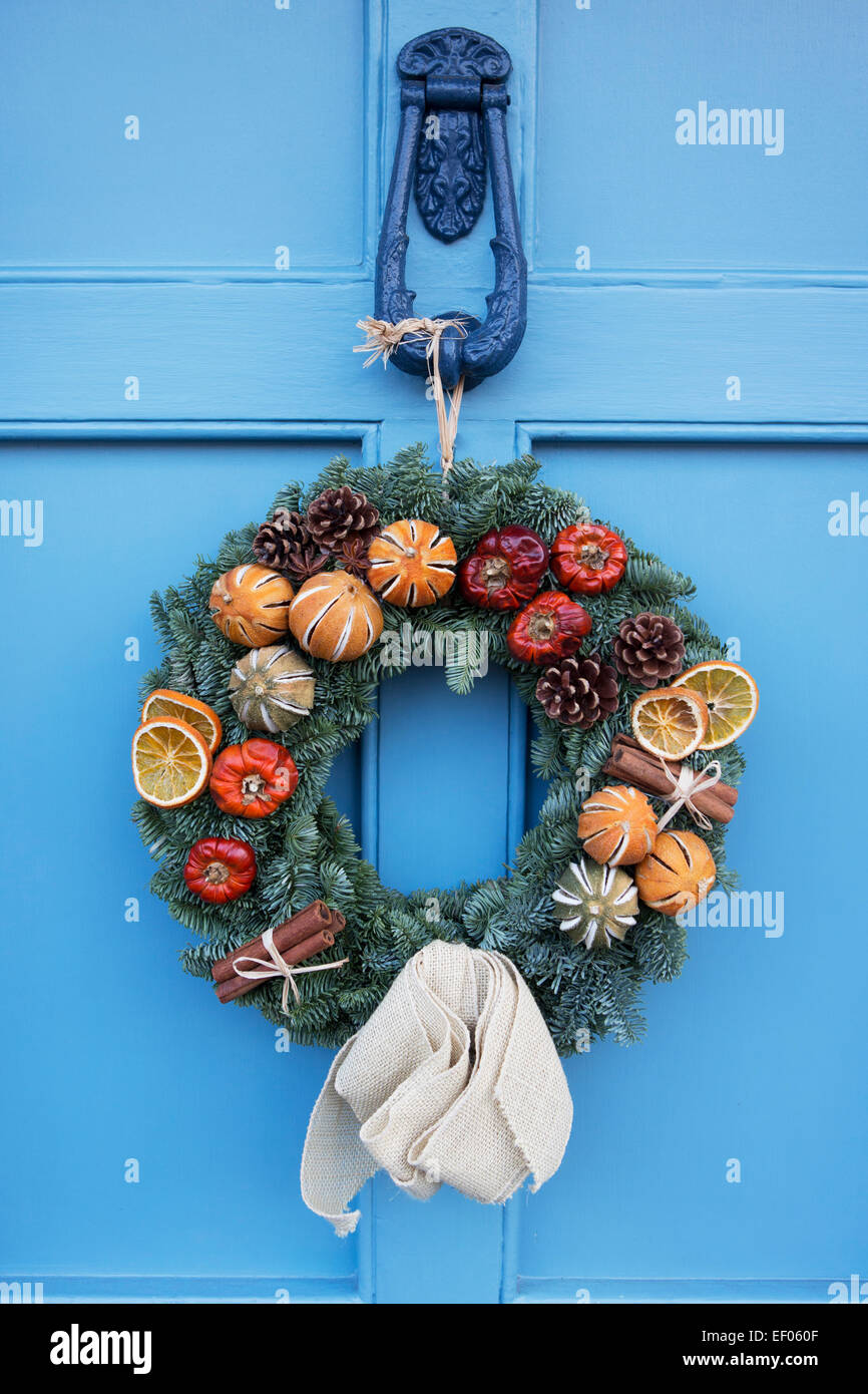 homemade christmas wreath hanging on blue door stock image