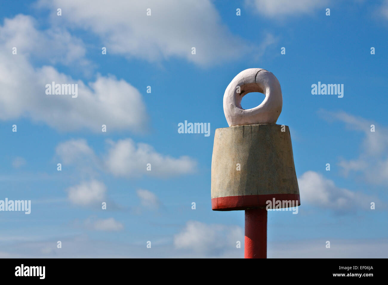 A sign against a blue sky. - Stock Image