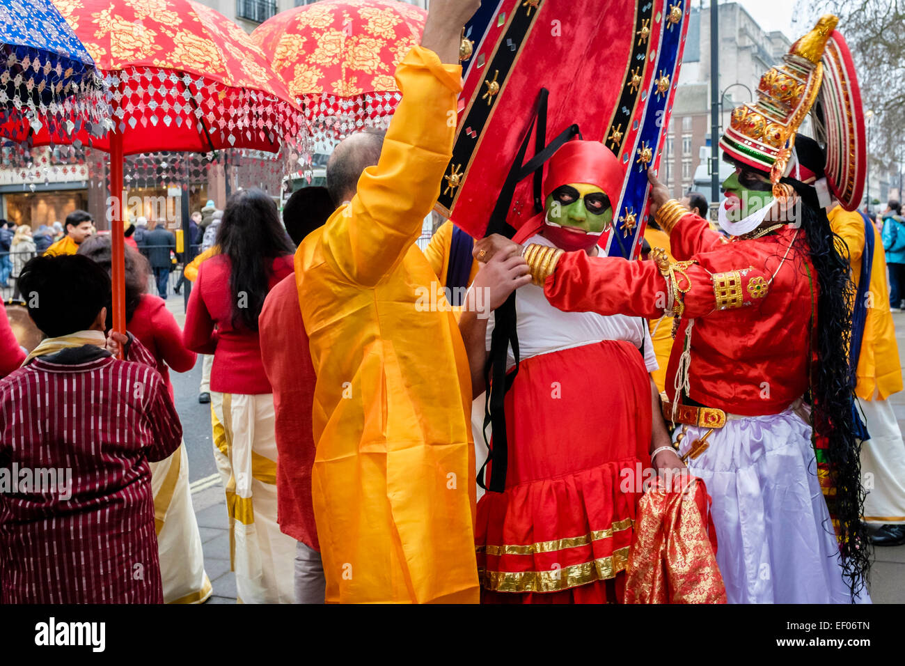 Participants in London 2015 New Year's Day Parade prepare costumes. - Stock Image
