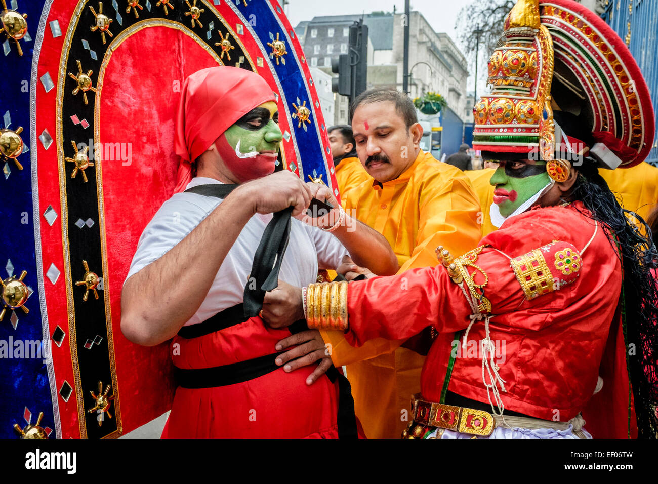 Participants in London 2015 New Year's Day Parade prepare costumes - Stock Image