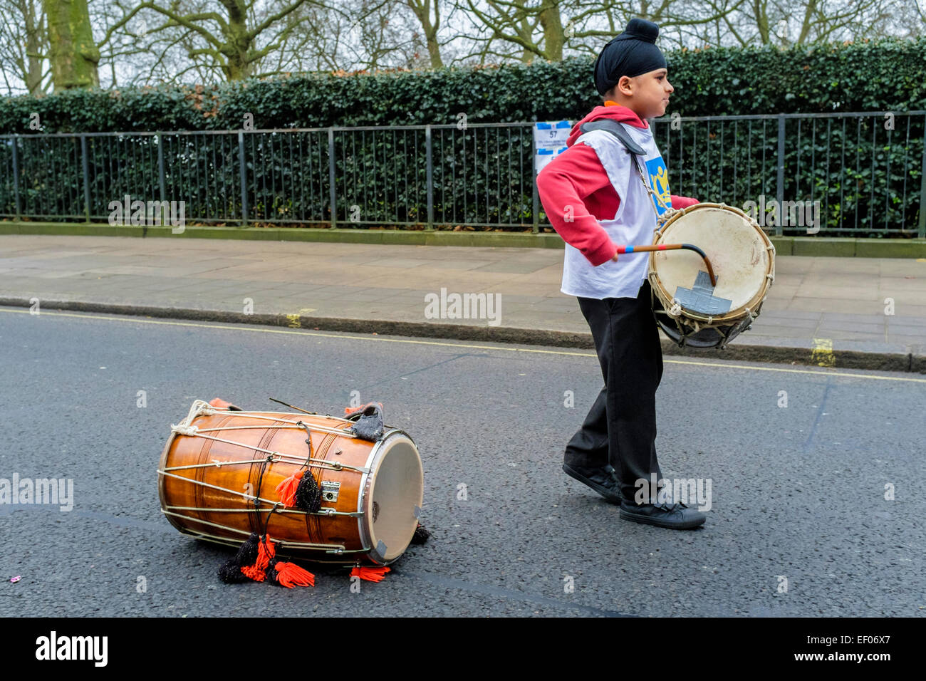 A young Borough of Lewisham drummer prepares to participate in London 2015 New Year's Day Parade - Stock Image