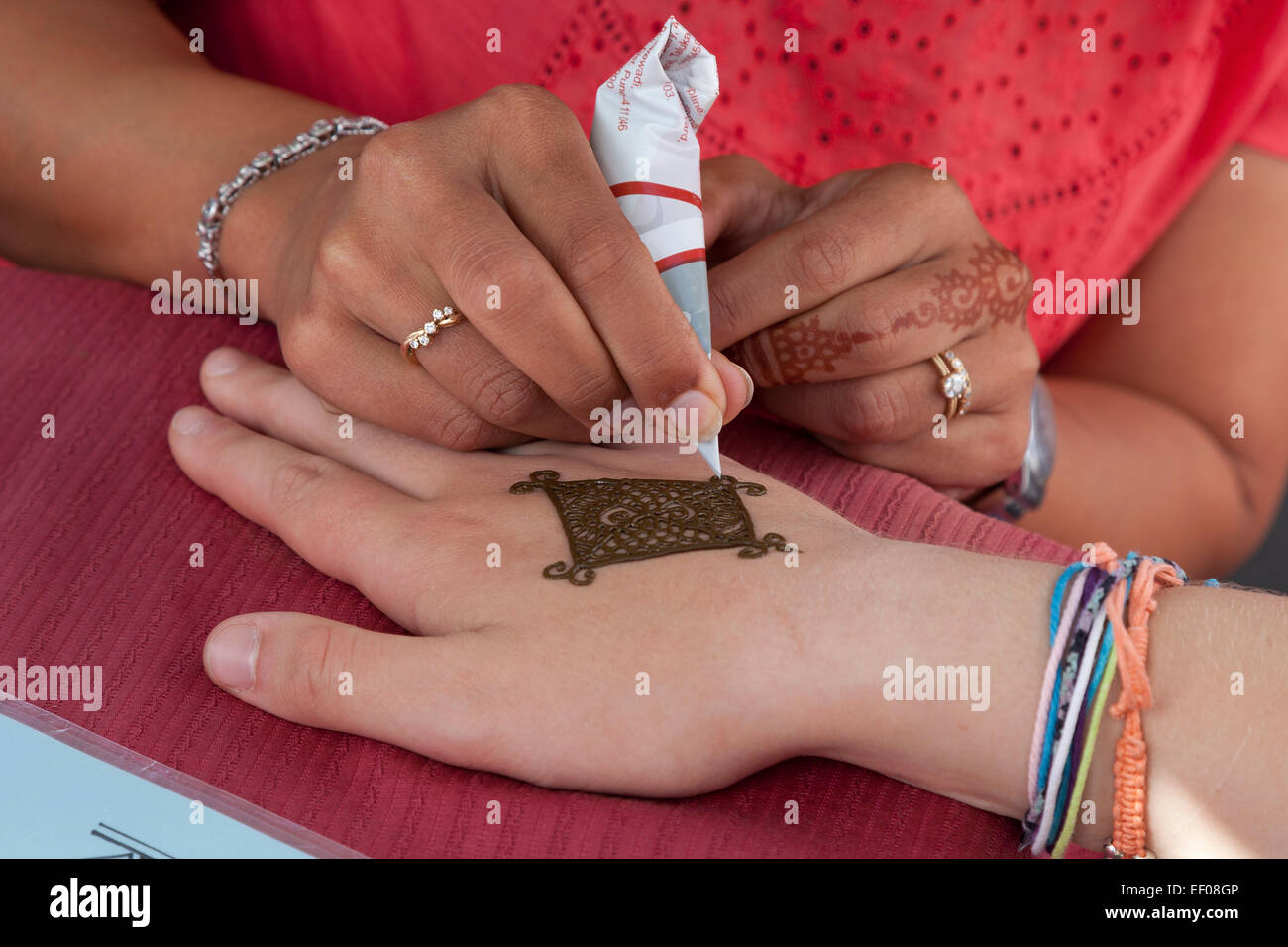 Traditional henna painting on a hand - Stock Image