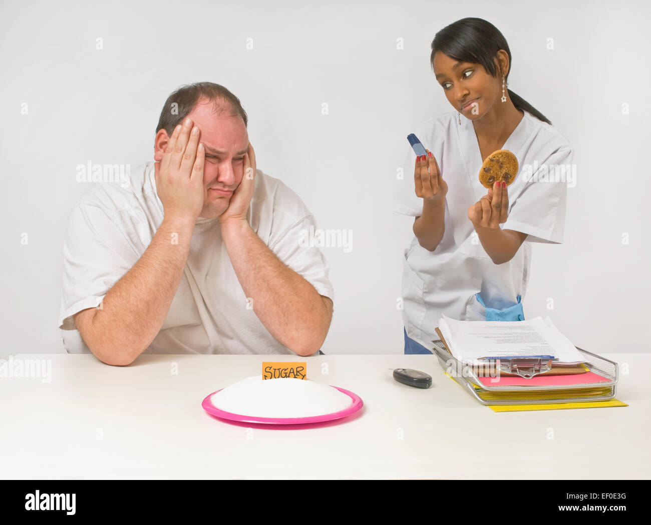 Frustrated diabetic man - Stock Image