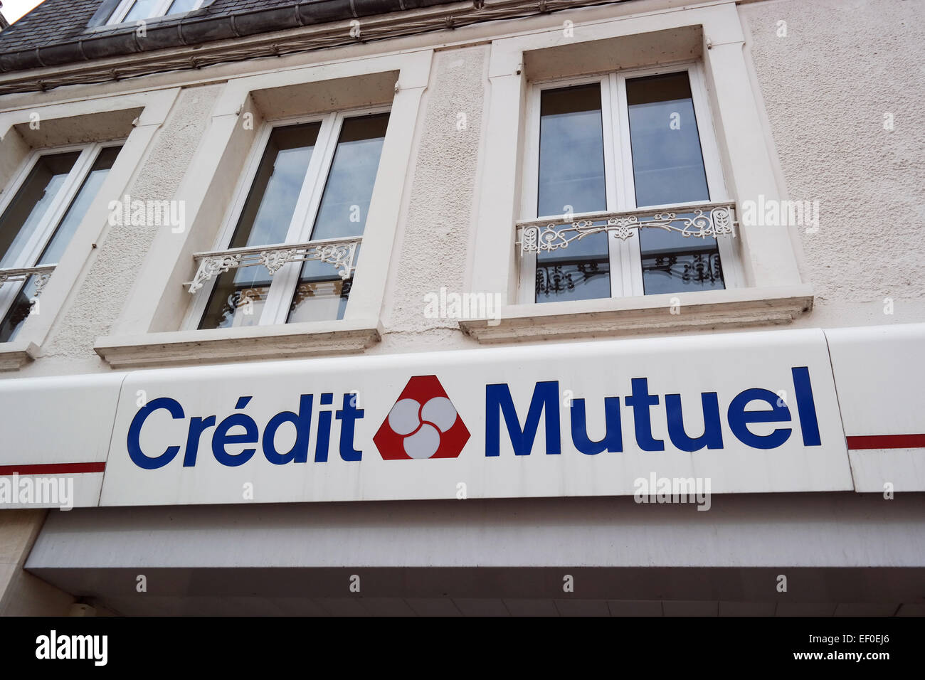 CARENTAN, FRANCE - JULY 2014: Branch of Credit Mutuel in Normandy. Credit Mutuel is a major French bank - Stock Image
