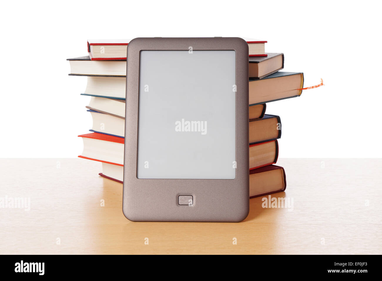 ebook reader vs pile of books - Stock Image