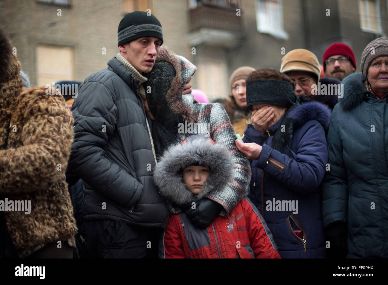 Donetsk, Ukraine. 24th Jan, 2015. Local citizens attend a mourning ceremony for people, who died in an explosion Stock Photo