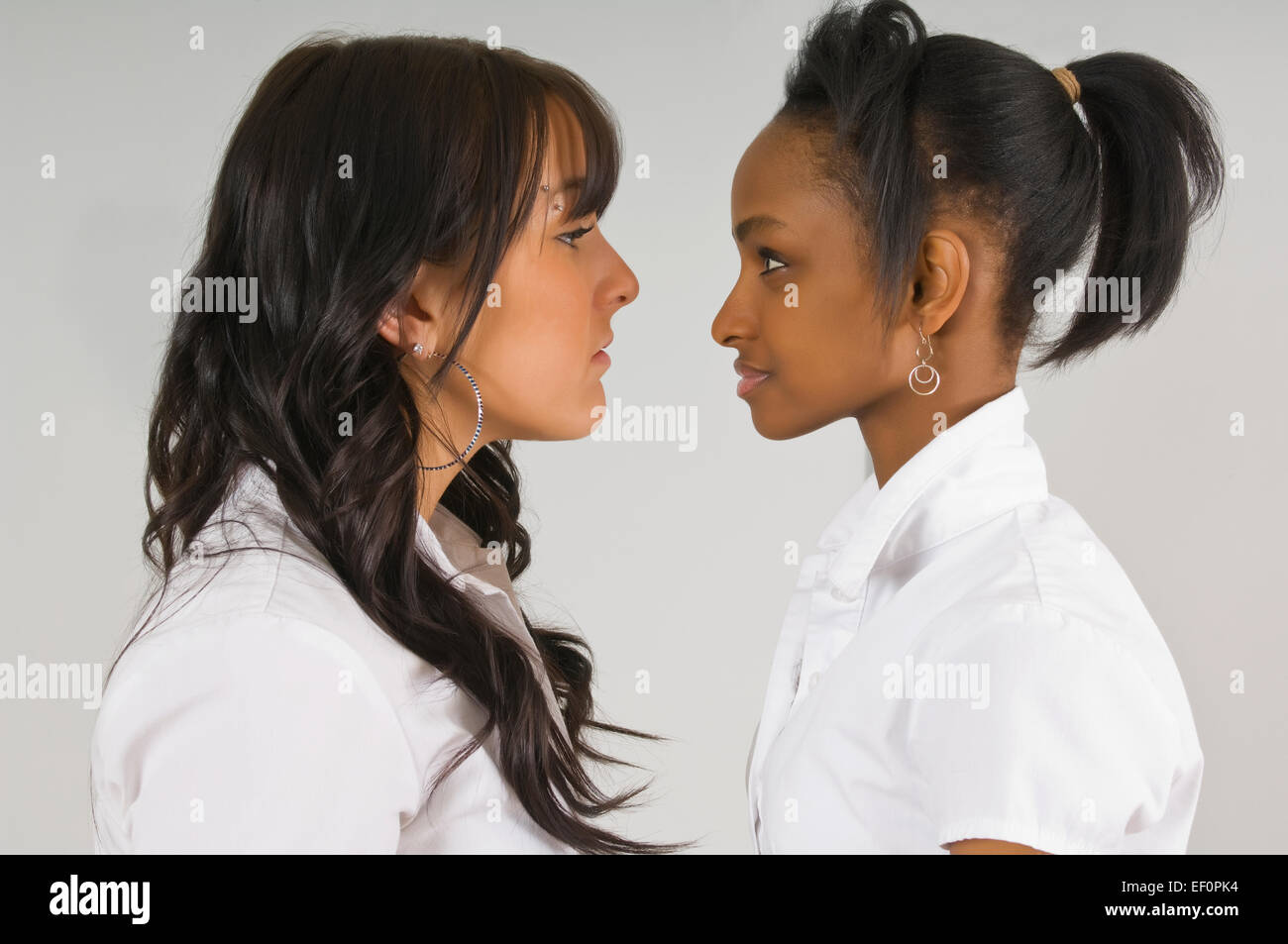 fd9629404b Two young women staring at each other Stock Photo  78079096 - Alamy