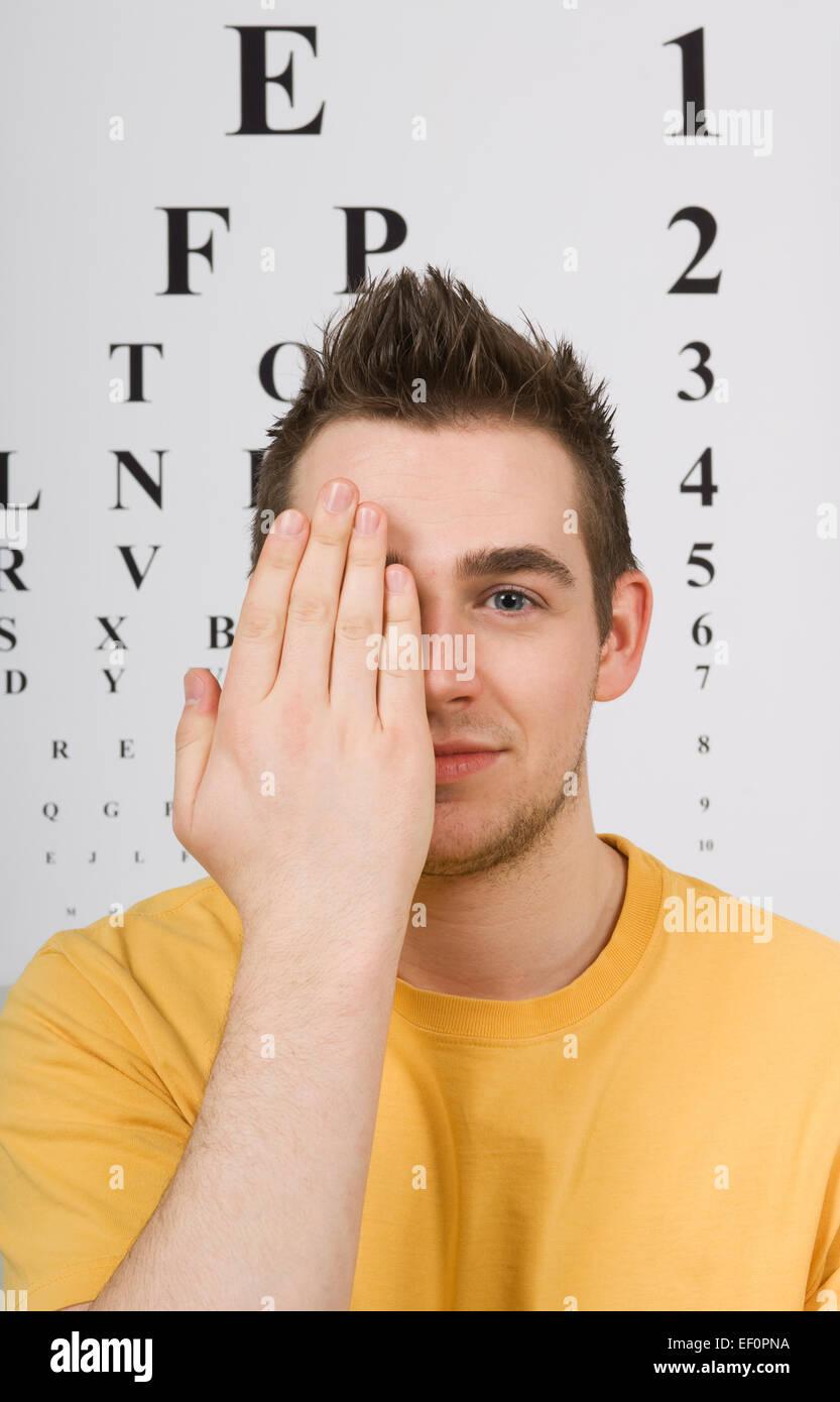 Man having eye test - Stock Image