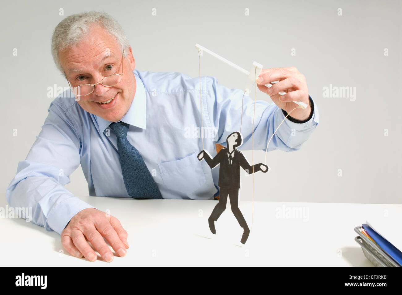 Man playing with a puppet - Stock Image