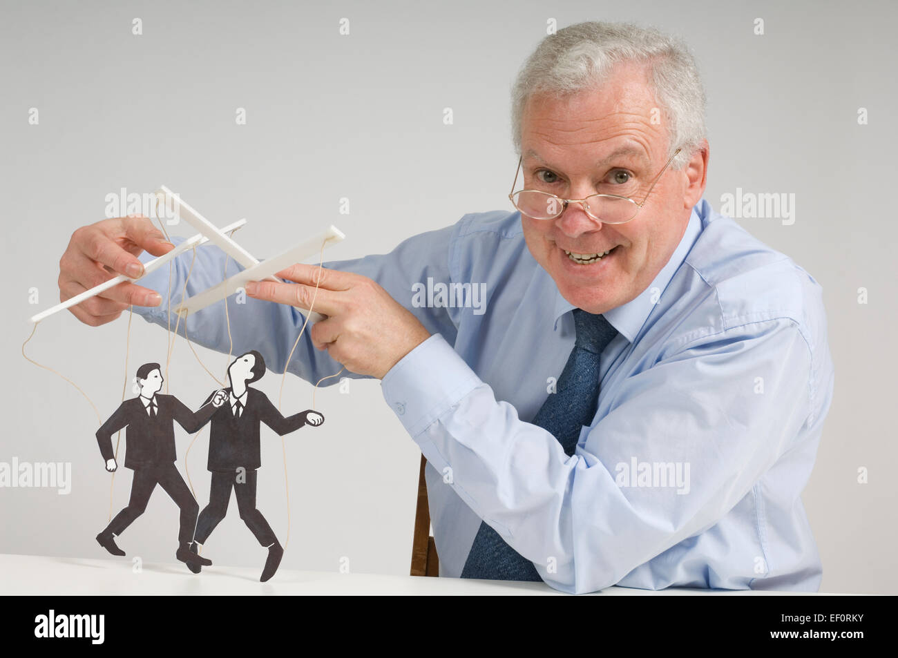 Man playing with puppets - Stock Image