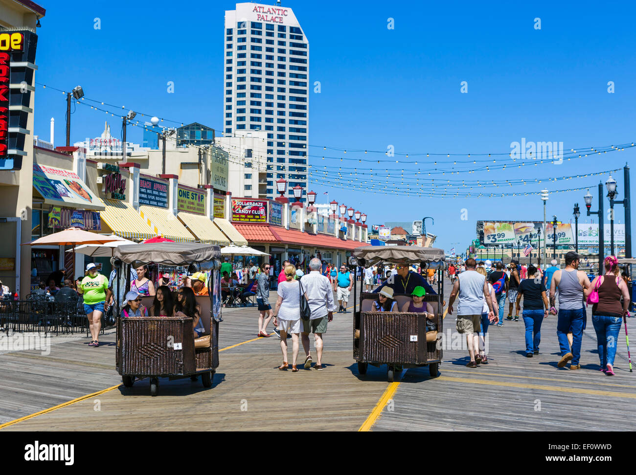 Famous Rolling Chairs on the boardwalk in Atlantic City, New Jersey, USA - Stock Image