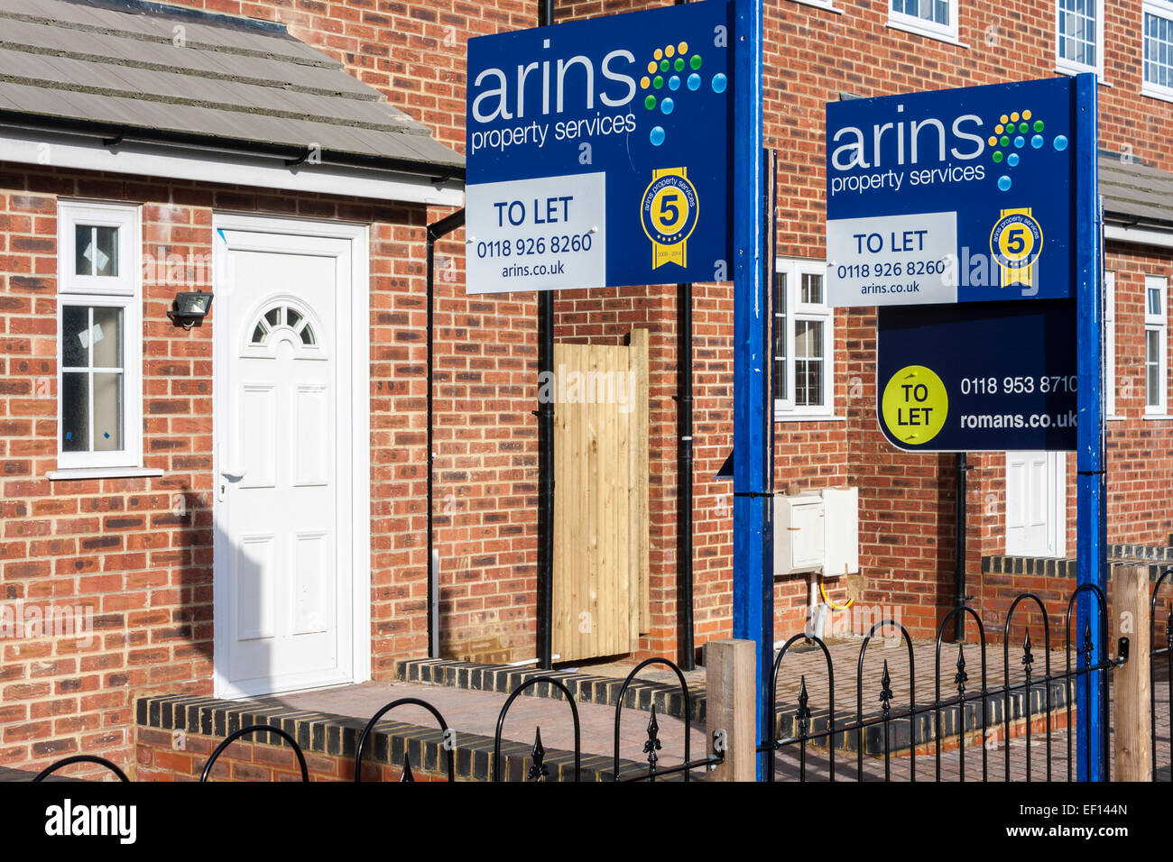 New housing with 'to let' signs. - Stock Image