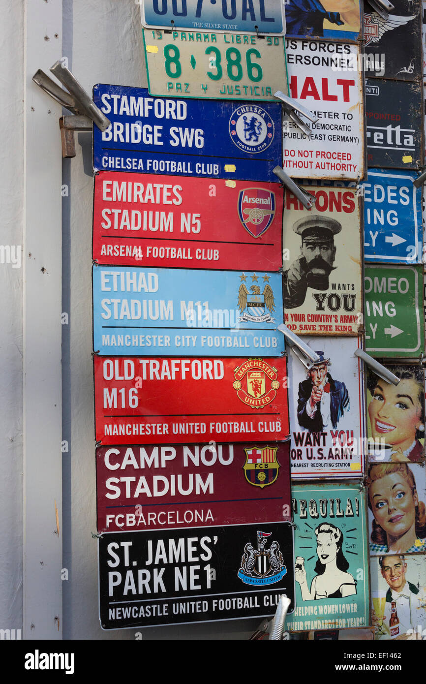 Metal signs of football grounds, UK stadiums and Barcelona, on sale at Portobello Market, Notting Hill, London - Stock Image