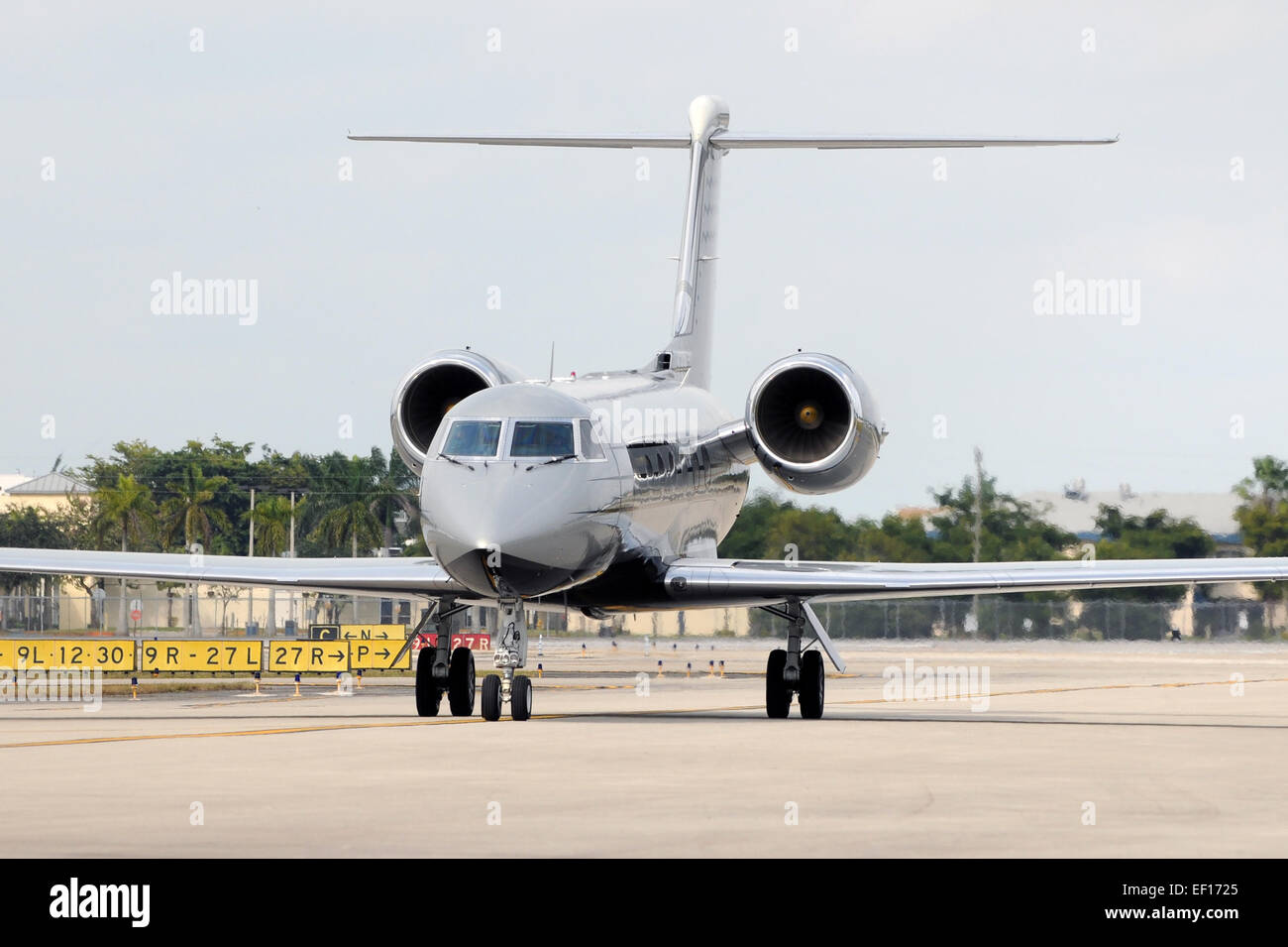 Luxury private jet taxiing on the ground - Stock Image