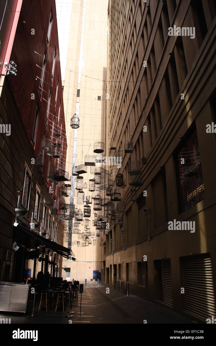 In Angel Place, empty birdcages can be seen overhead. Michael Thomas Hill created the installation known as Forgotten - Stock Image