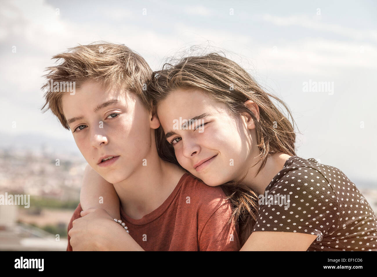 sister hugging her brother, toned image - Stock Image