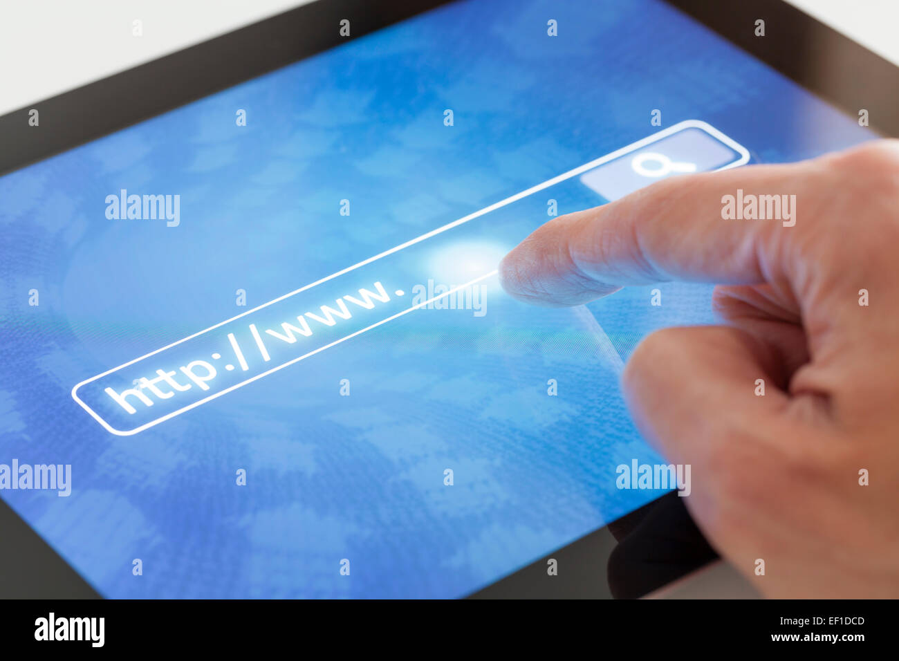 Internet search using a tablet - Stock Image