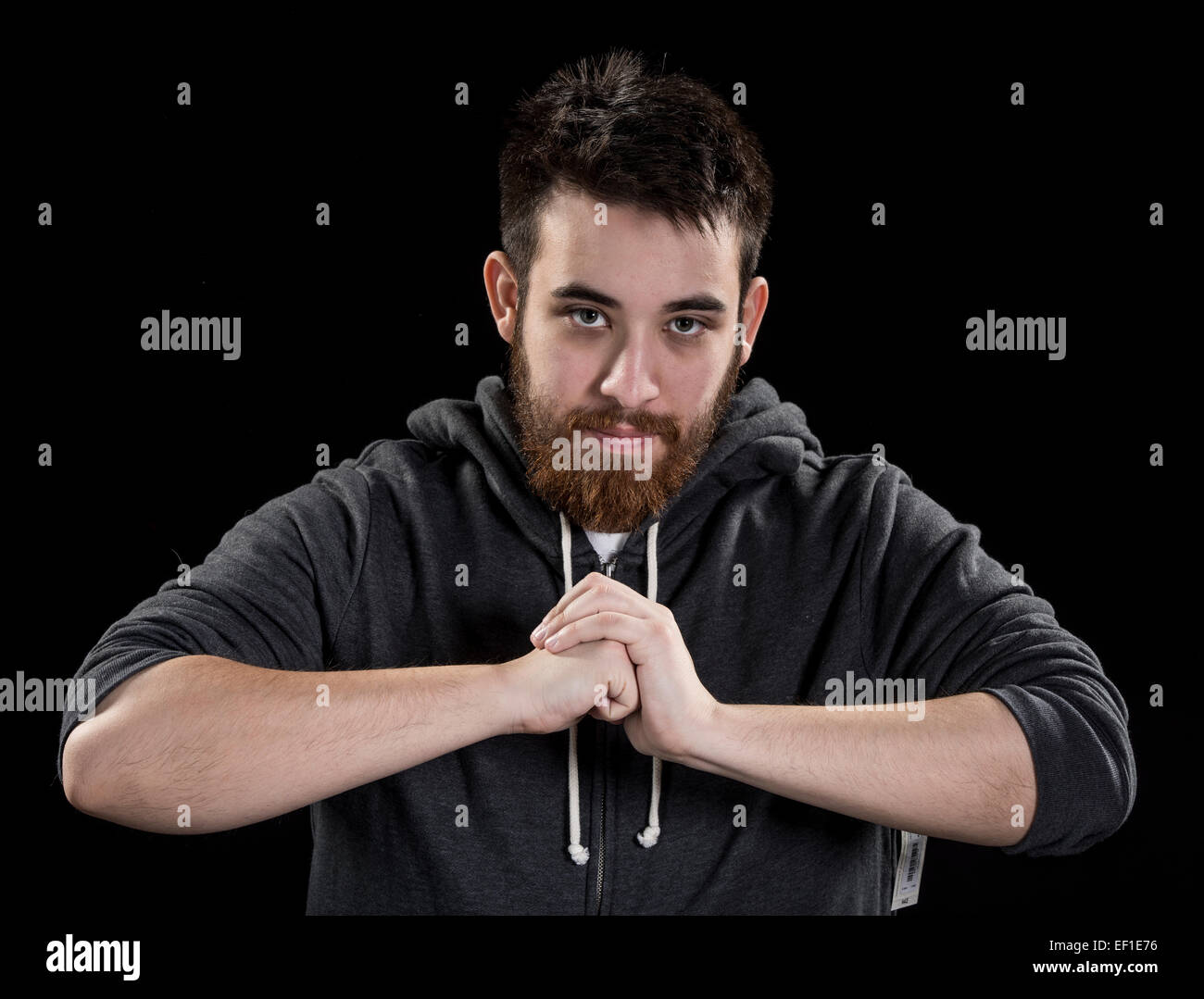 Serious Man with Closed Fist In Front his Body - Stock Image