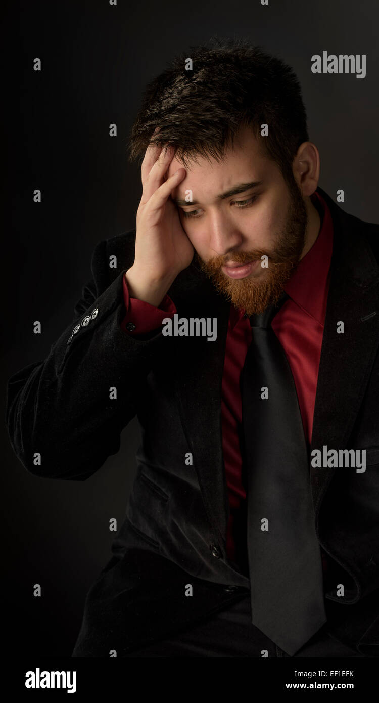 Worried Goatee Man in Formal Suit - Stock Image
