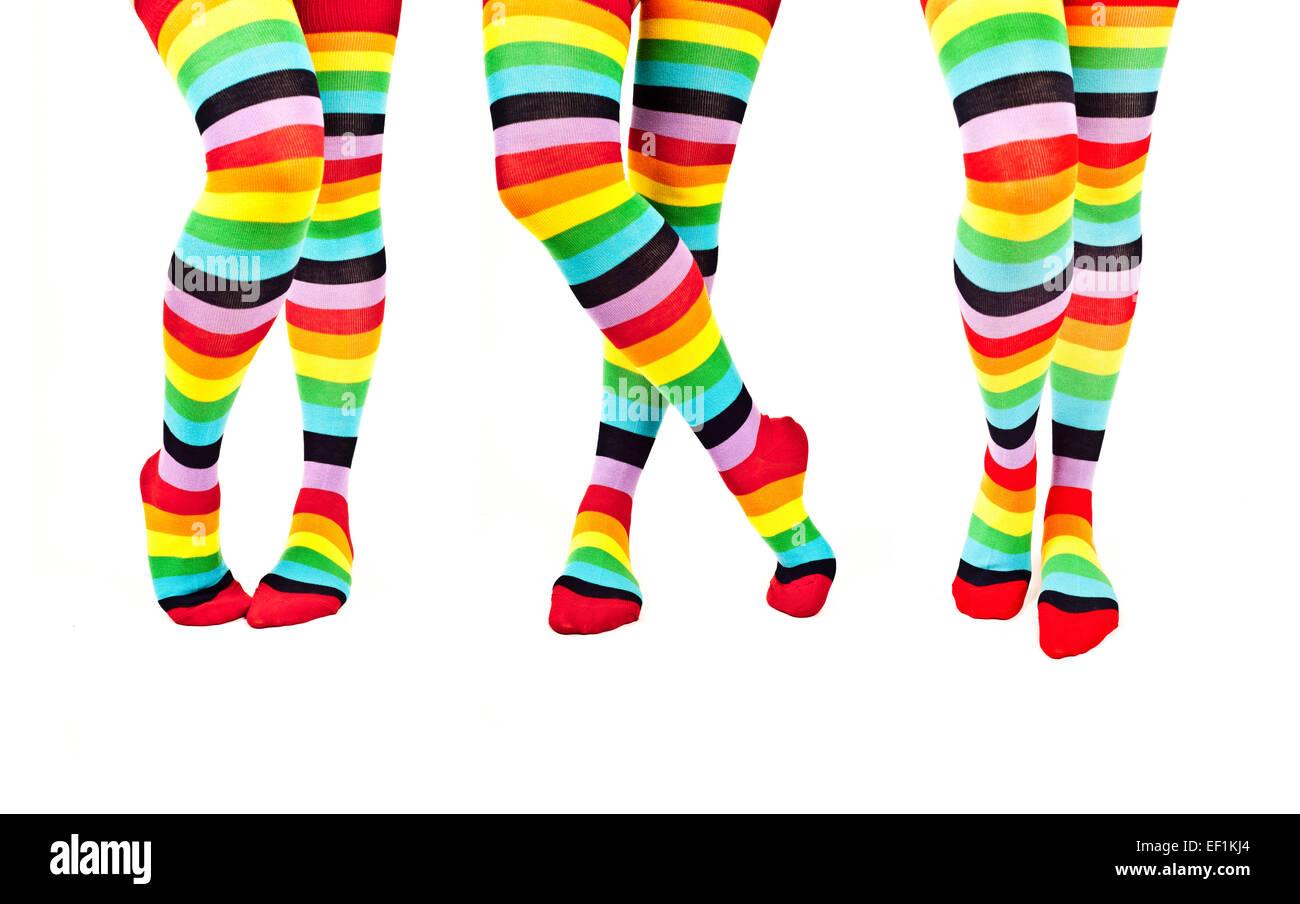 woman legs wearing rainbow colorful knee high socks, isolated - Stock Image