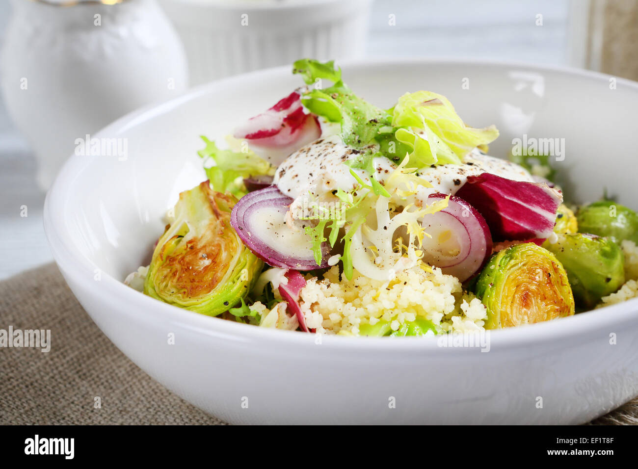 Healthy salad with couscous in a bowl, food - Stock Image