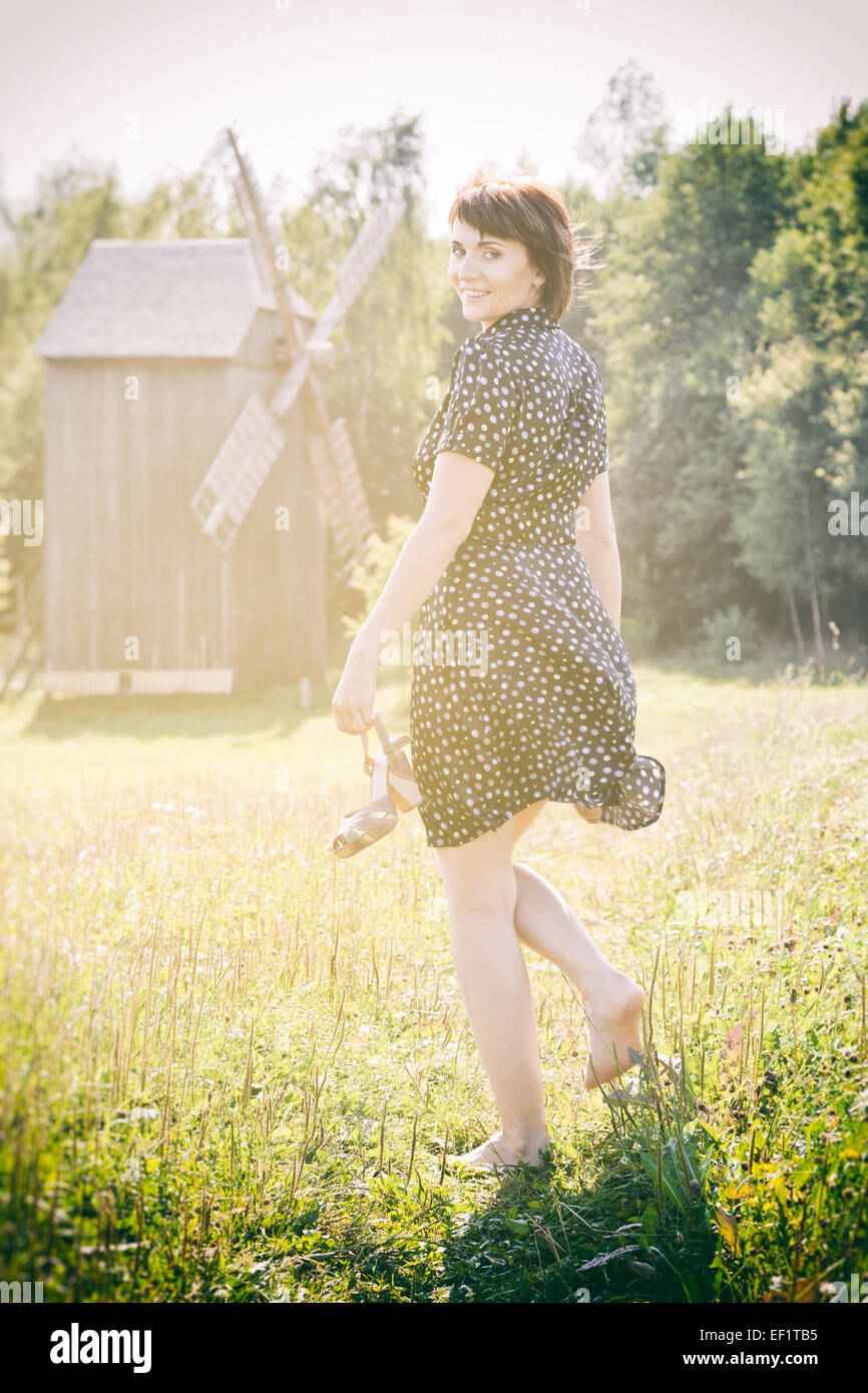 beautiful young woman outdoors in village Stock Photo