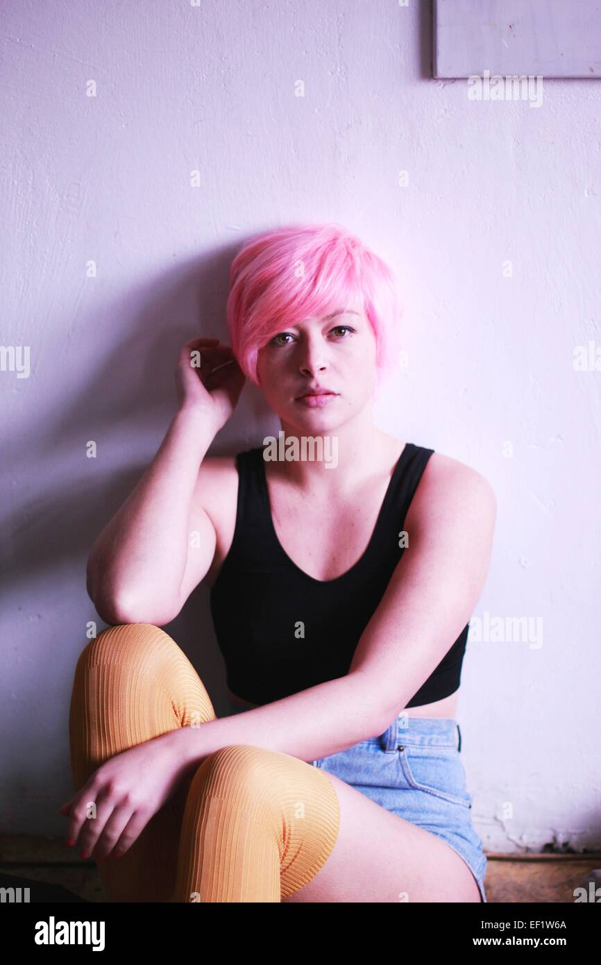 Young girl with pink hair Stock Photo