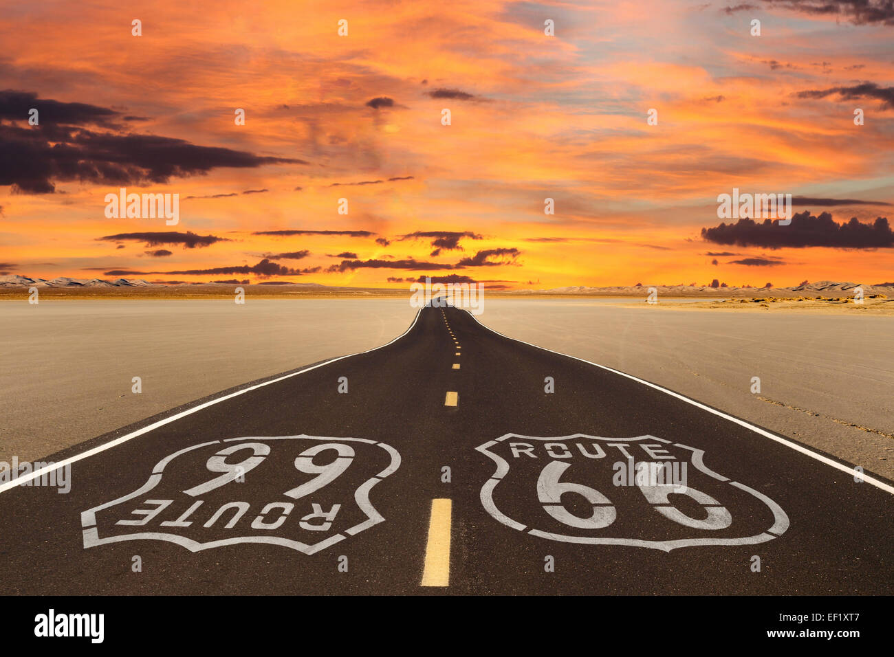Romanticized rendition of Route 66 crossing a dry lake bed in the vast Mojave desert. - Stock Image