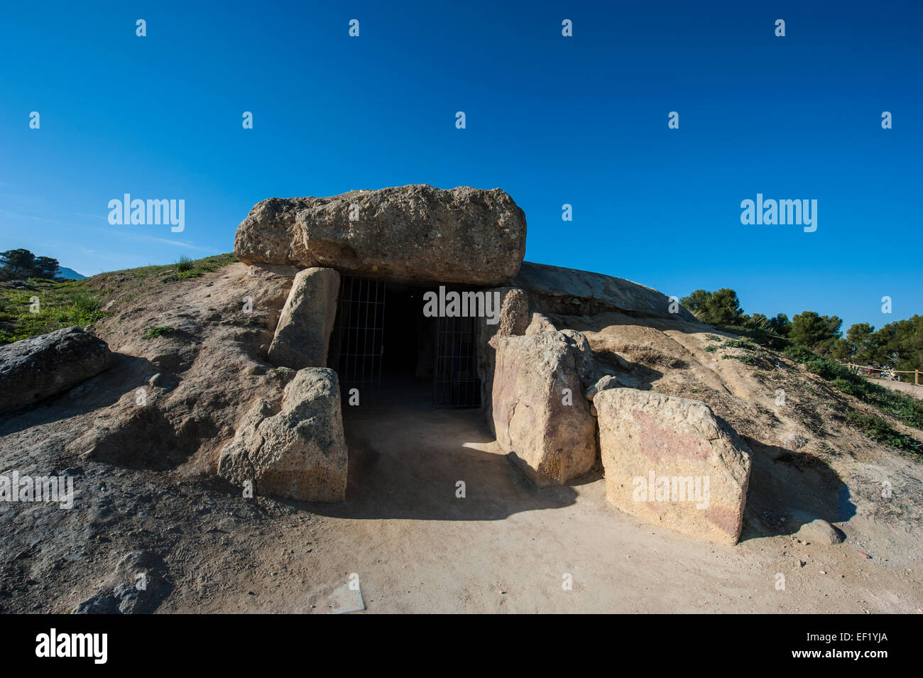 Dolmen of Menga, a megalithic burial mound located near Antequera, Málaga, Spain. Stock Photo