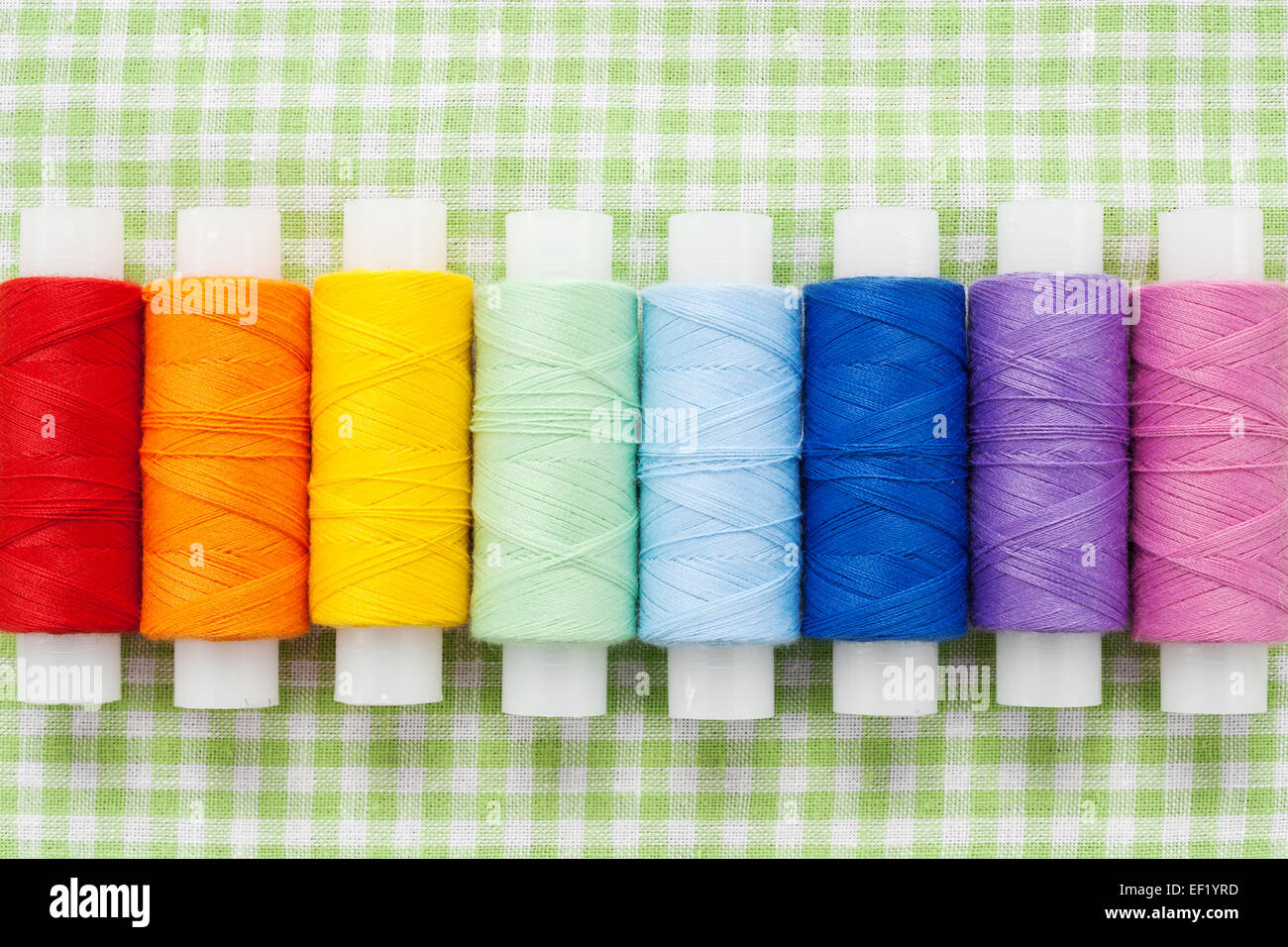 spools of colorful thread, skein collection, top view - Stock Image