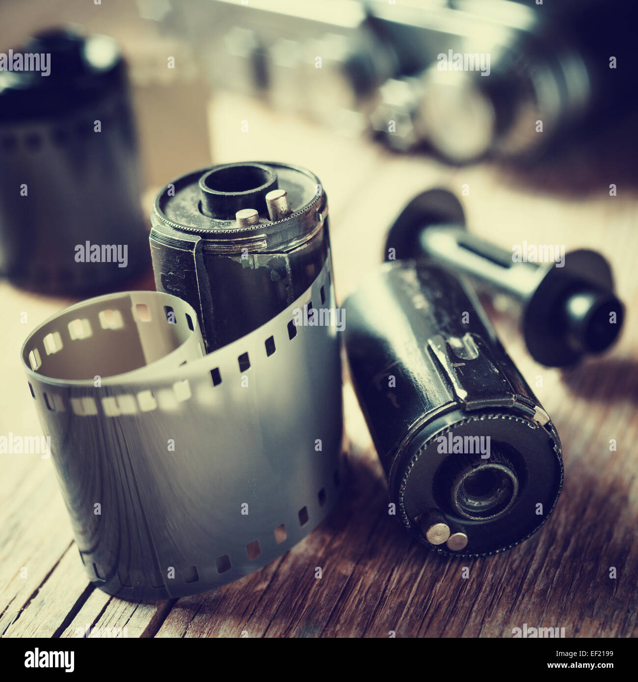 Old photo film rolls, cassette and retro camera. Vintage stylized. - Stock Image