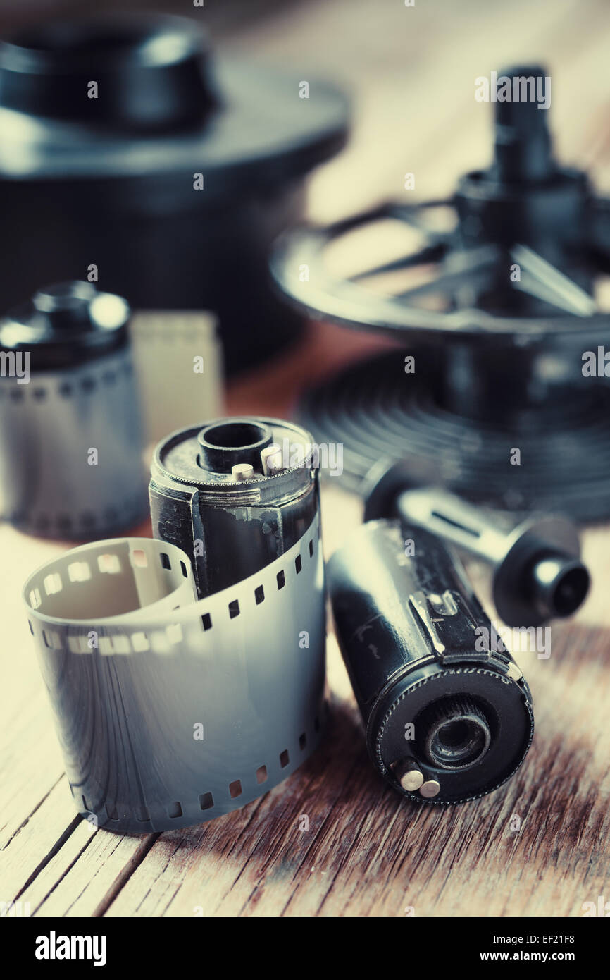 Old photo film rolls, cassette and photographic equipment. Vintage stylized. - Stock Image