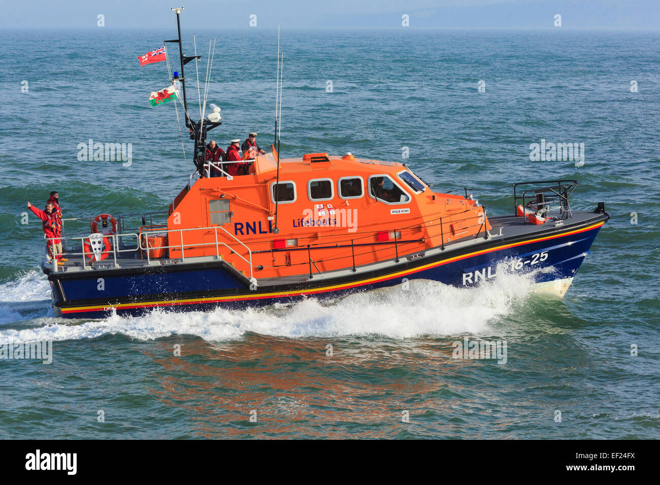 "RNLI lifeboat crew at sea in new Tamar class vessel ""Kiwi"" in Moelfre, Isle of Anglesey, North Wales, UK, Britain Stock Photo"