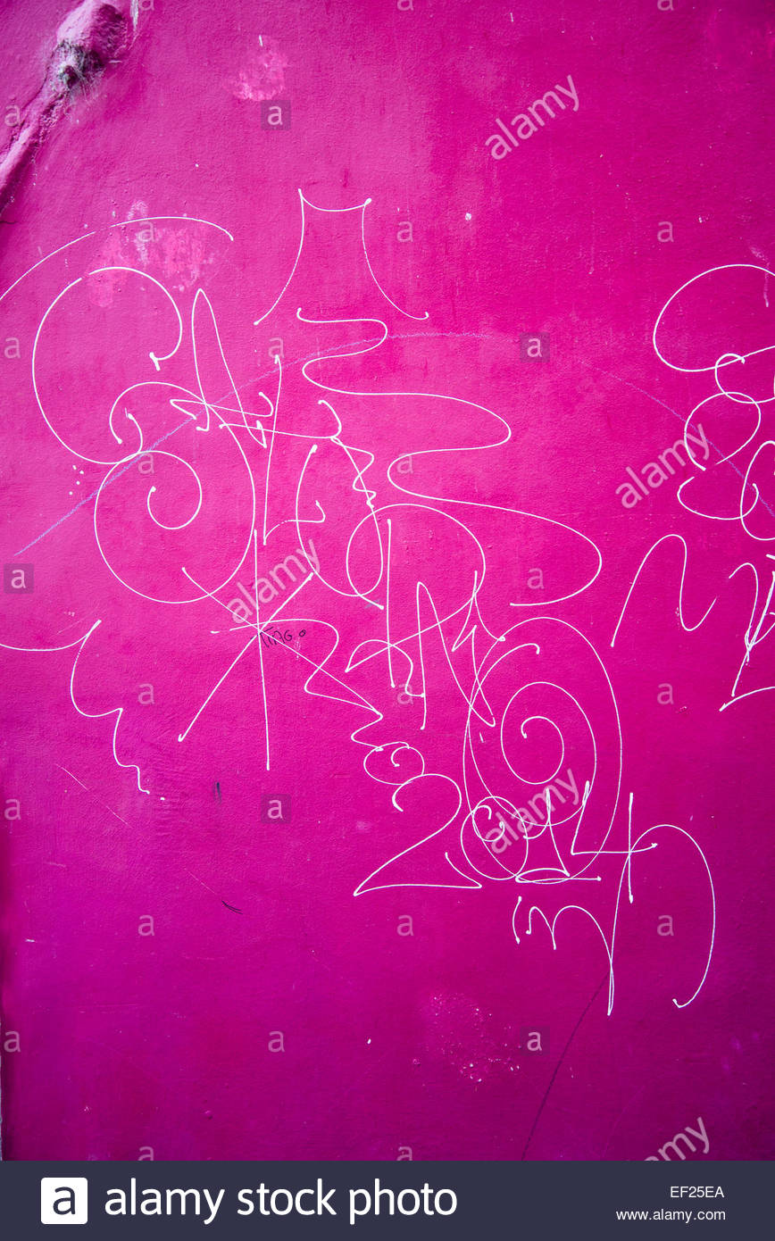 Scribble on pink wall - Stock Image