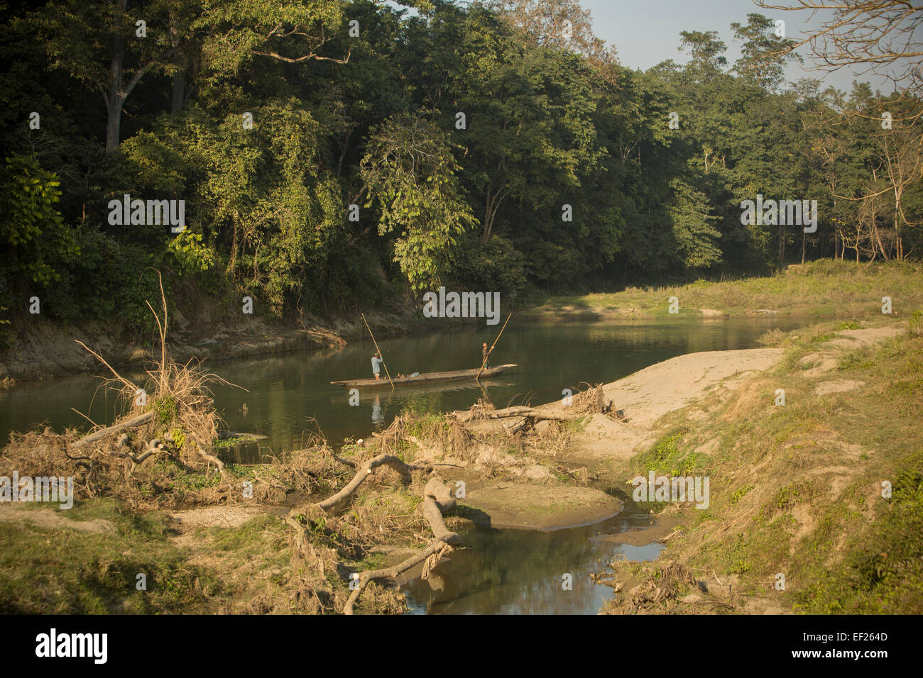 Boaters on the Rapti River - Chitwan National Park, Nepal - Stock Image