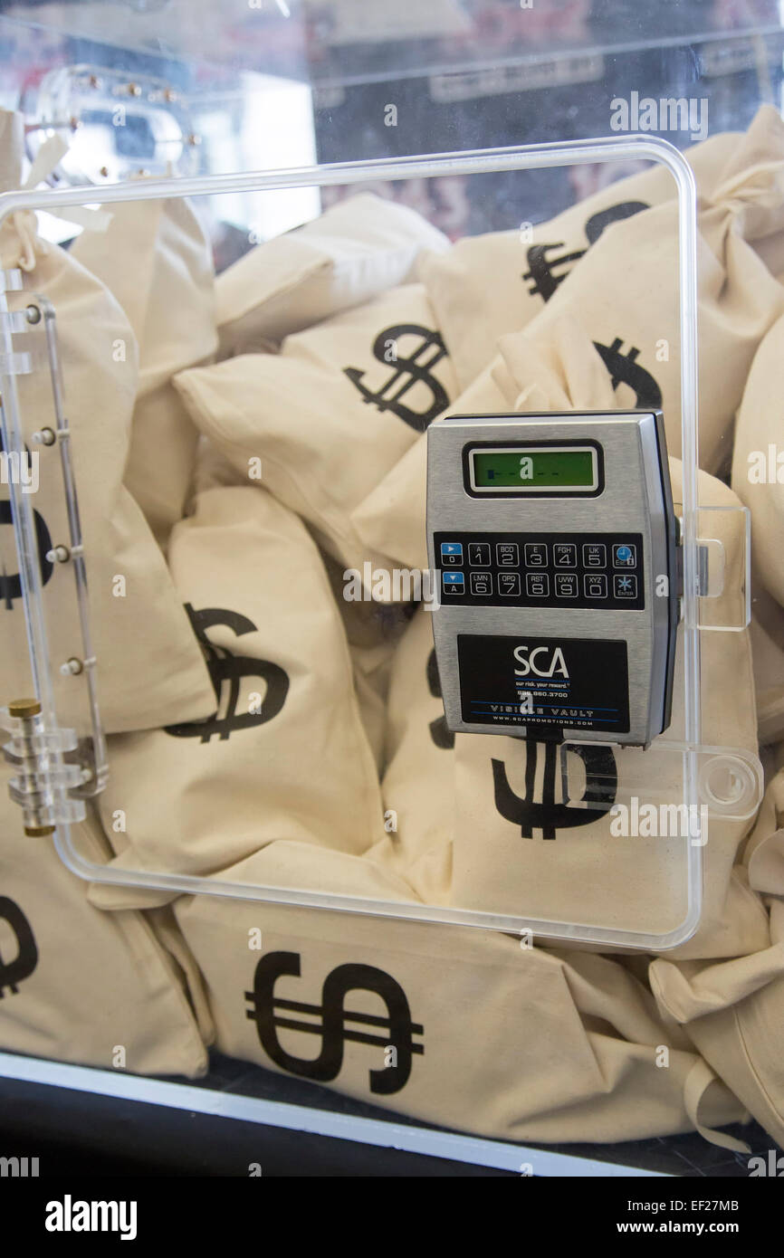 Detroit, Michigan - A radio station displayed money bags, offering $10,000 to anyone who could guess the vault's - Stock Image