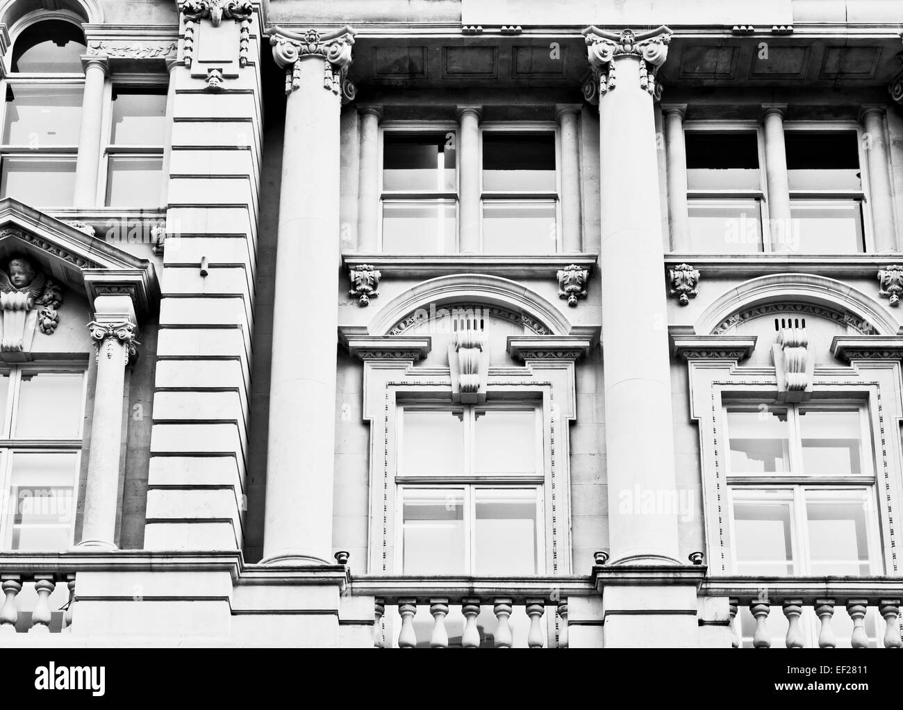 Details of pillars and windows in a well preserved building in the UK Stock Photo