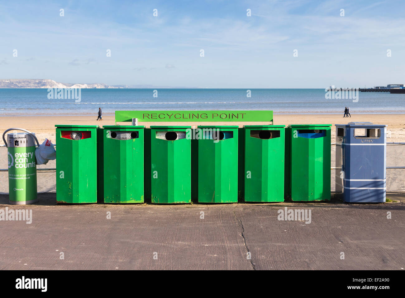A Recycling Point, recycling plastic, cans, clear glass, green glass, brown glass, paper and litter on Weymouth - Stock Image