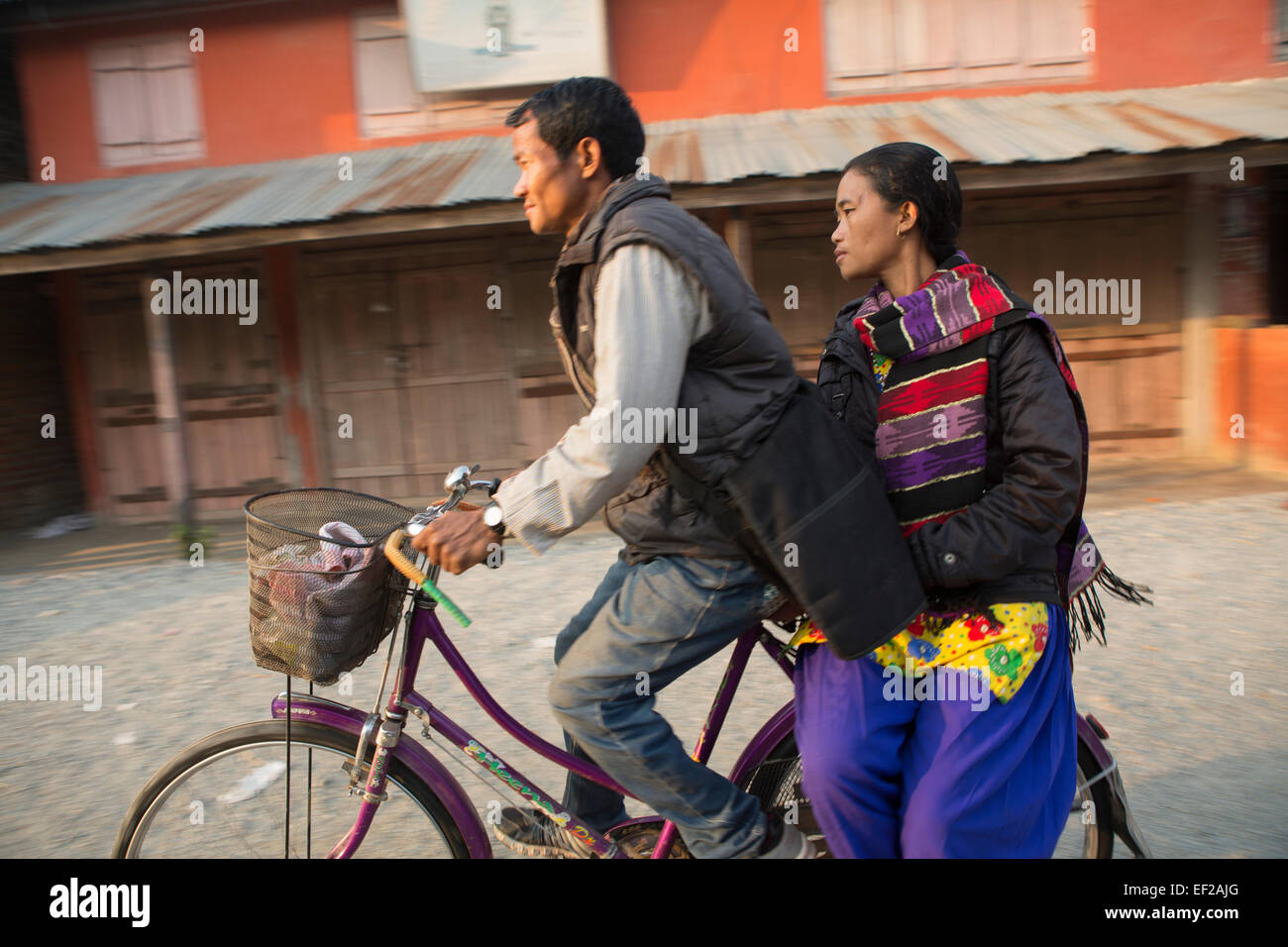 Bicyclers in the Terai - Shaktikhor, Nepal. - Stock Image