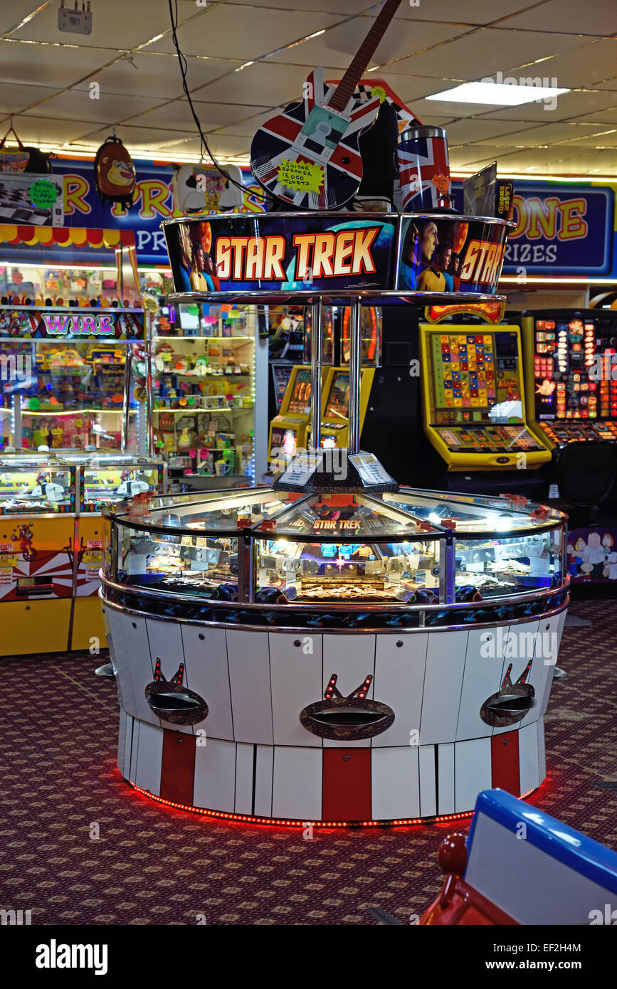 Coin Drop Machine in a seaside Amusement Arcade at Herne Bay, Kent. - Stock Image