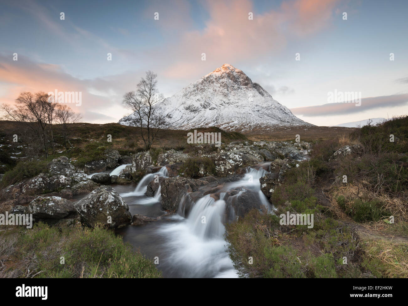 Snow dusted Stob Dearg, Buachaille Etive Mor, and waterfalls on the River Coupall, Glencoe, Scotland - Stock Image