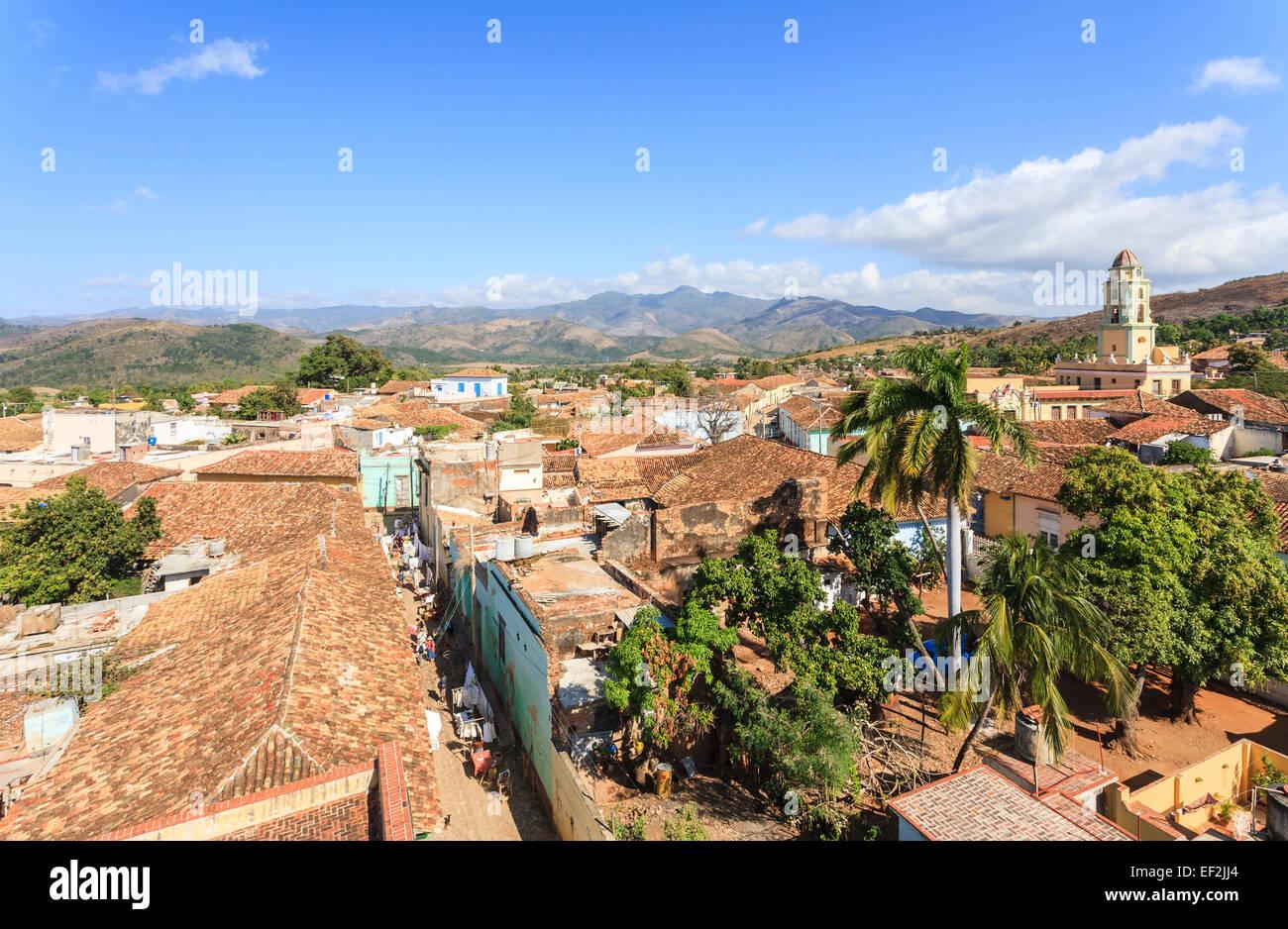 Panoramic terracotta tiled rooftop view over Trinidad, Cuba with Iglesia Parroquial de la Santísima Trinidad (Church Stock Photo