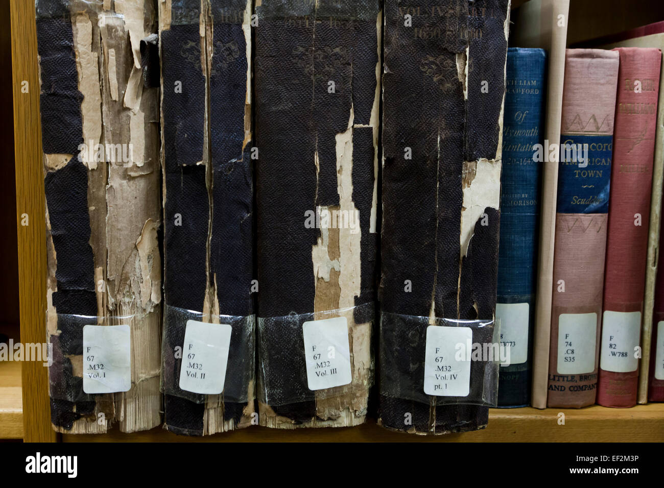 Frayed spine of old books on library shelf - USA - Stock Image